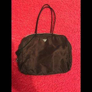 Brown Prada purse. 10 in length 13 in width
